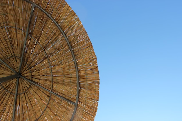 The umbrella of bamboo. copy space. straw beach sunshade view from above.