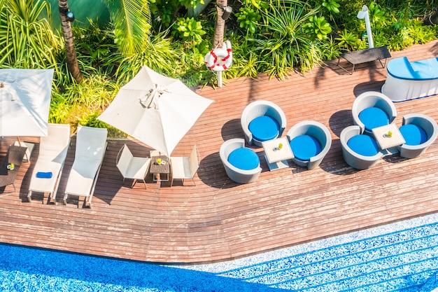 Umbrella and chair around beautiful luxury swimming pool