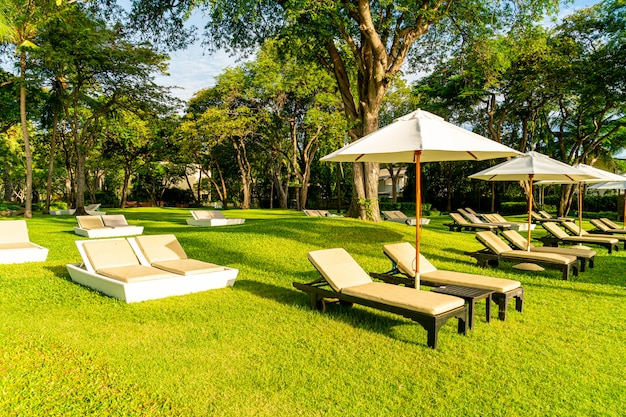 Umbrella and chair in garden for sun bathing or relax