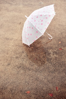 A umbrella on concrete floor.