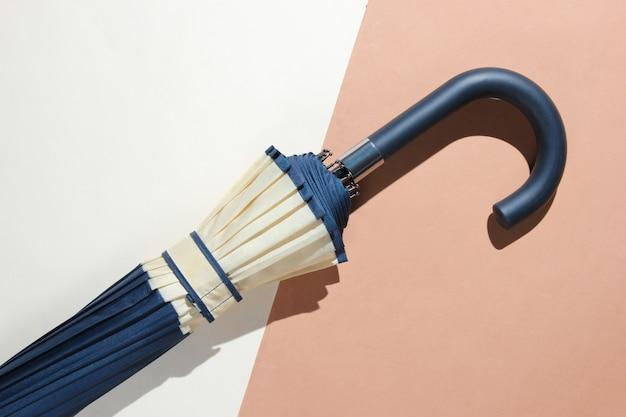 Umbrella handle on beige surface