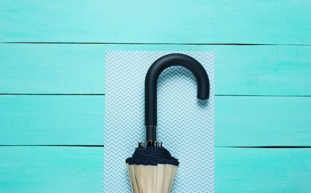 Umbrella hook on blue surface