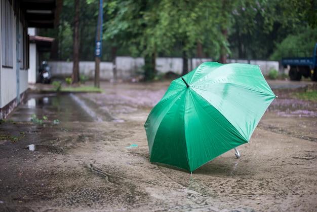 The umbrella placed in the rain.