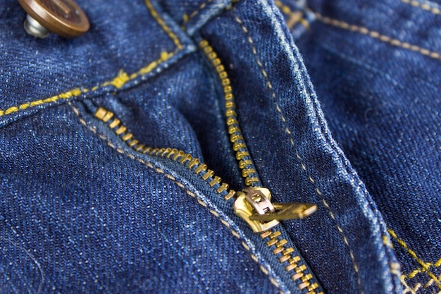Unbuttoned zip zipper on jeans. jeans front with zipper open.