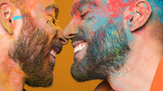 Unclean faces gay couple enjoying each other