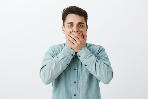Uncomfortable worried caucasian man in shirt