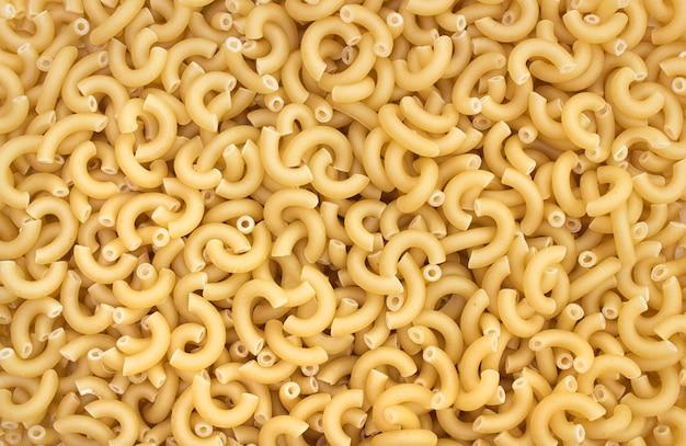 Uncooked elbow pasta background