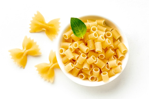 Uncooked farfalle and rigatoni bowl