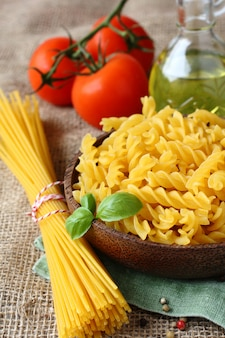 Uncooked gluten free pasta from blend of corn and rice flour