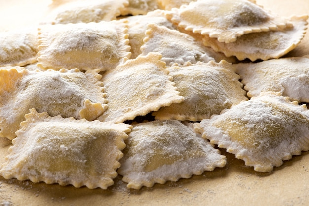 Uncooked italian ravioli pasta