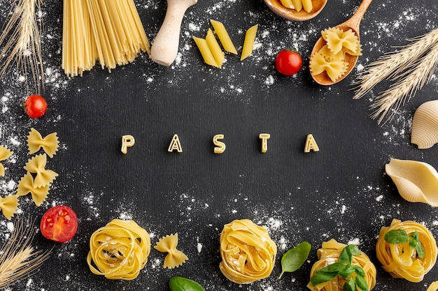 Uncooked pasta arrangement with alphabet pasta on black background