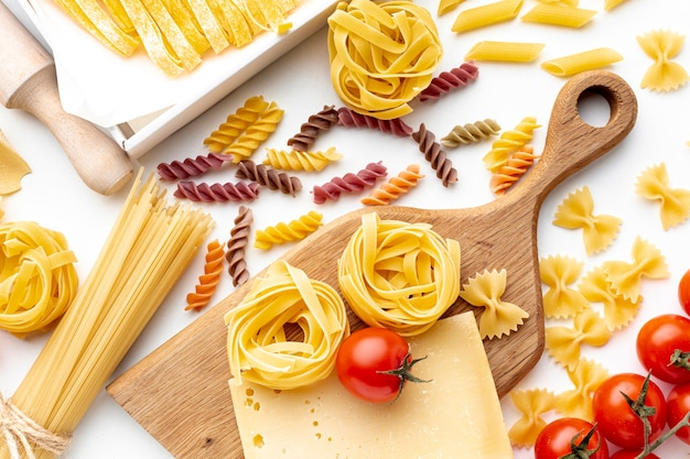 Uncooked pasta mix with tomatoes and hard cheese
