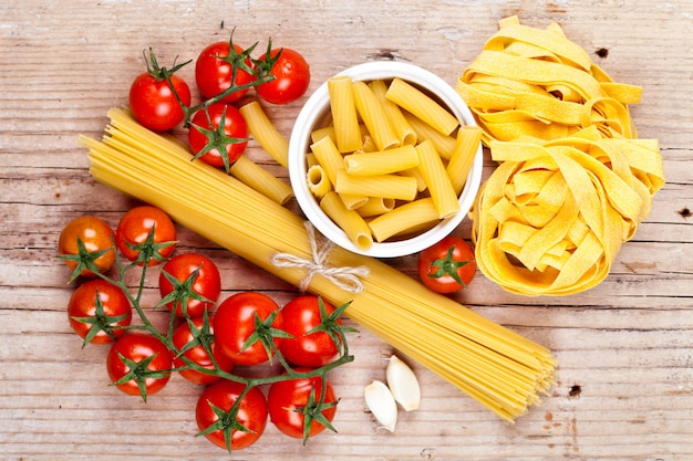Uncooked pasta with tomatoes