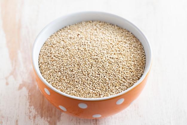Uncooked quinoa on bowl