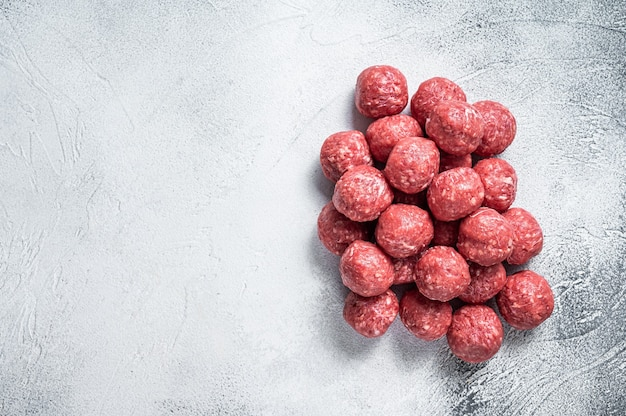 Uncooked raw beef and pork meatballs pile