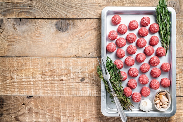 Uncooked raw beef and pork meatballs