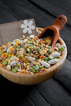 Uncooked soup of various colored mixed legumes with barley, spelled,peas, beans, lentils and broad beans in glass jar