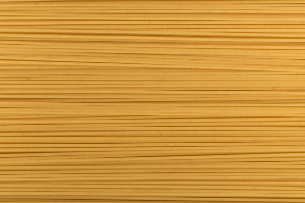 Uncooked spaghetti in close-up. italian national cuisine. pasta background