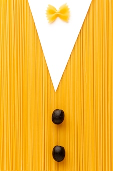 Uncooked spaghetti farfalle olives in suit shape