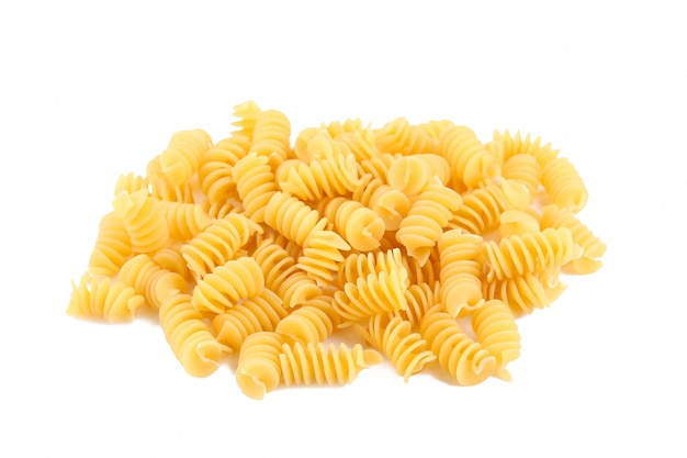 Uncooked spirelli isolated on a white background.