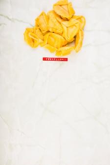 Uncooked tortelloni pasta on marble