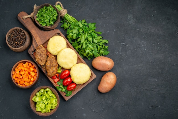 Uncooked vegetables on a brown cutting board