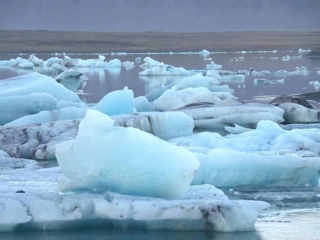 Uncountable blue icebergs floating on jokulsarlon glacier lagoon, south iceland