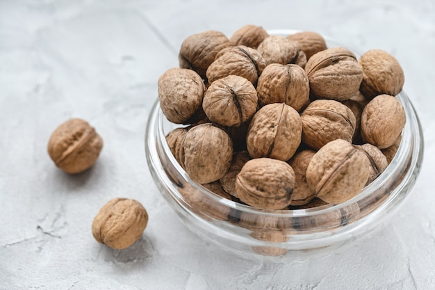 Uncracked walnuts in shell in bowl