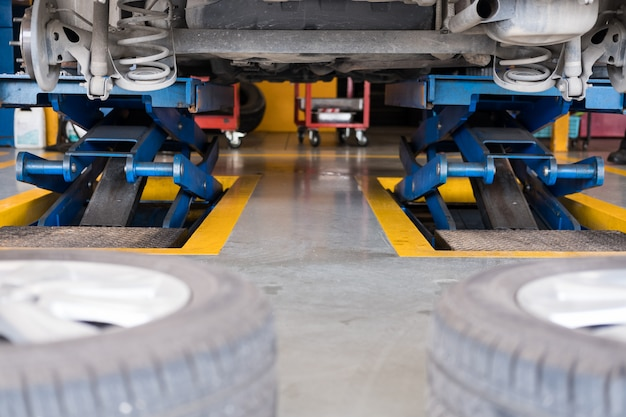 Undercarriage of a car in garage. vehicle maintenance in auto repair service.