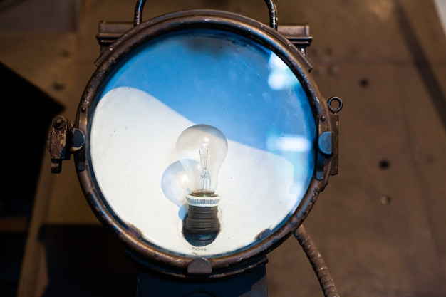 Undercarriage floodlight with incandescent lamp of a vintage steam locomotive