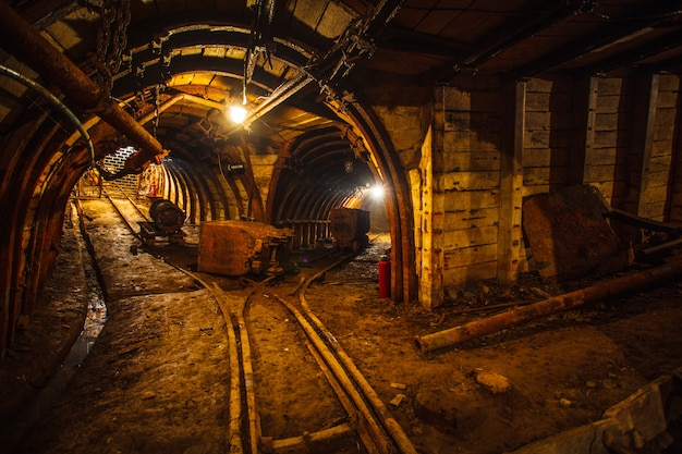 Underground mining tunnel with rails