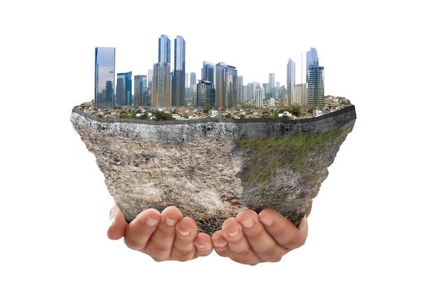 白い背景の上に分離された上部に都市の景観を持つ断面地球の地下土壌層