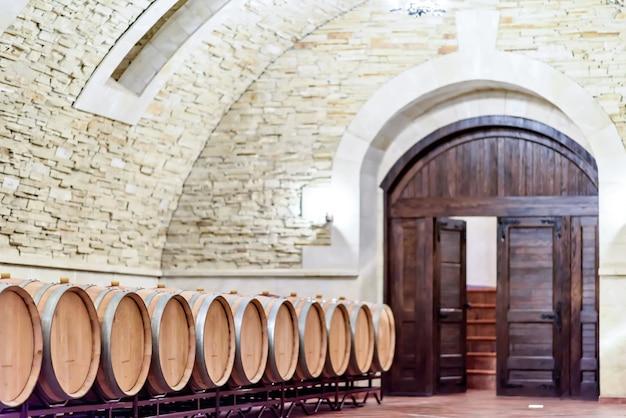 Underground wine cellar with wooden barrels, moldova