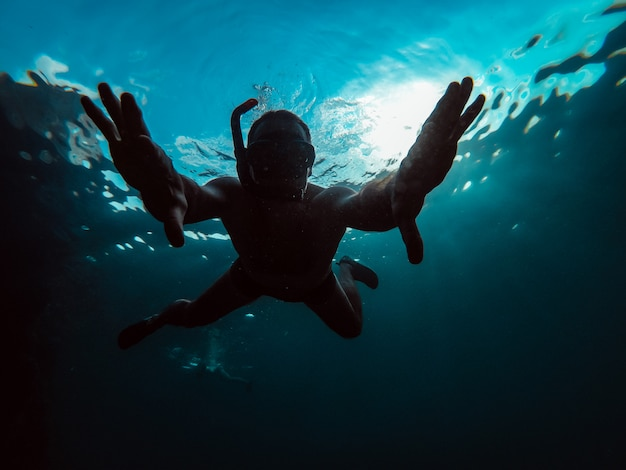 Underwater photo of man snorkeling in a sea