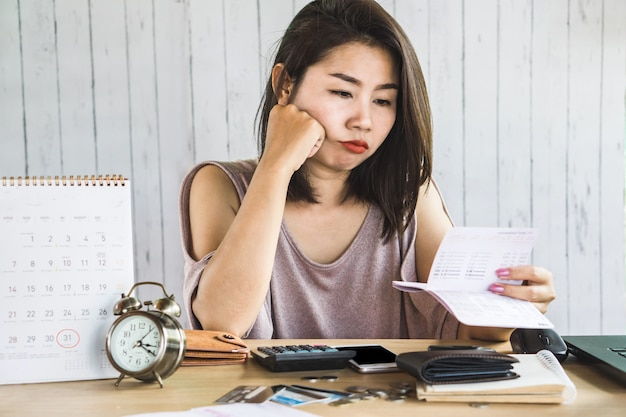 Unemployment asian woman looking at saving account