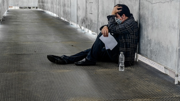 Unemployment and mental health problem. post-traumatic stress disorder (ptsd). resignation and stressful. corona virus job losses in asia. economic problems for workers.