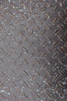 The uneven floor of the metal wall