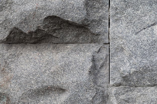 Uneven grey stone wall
