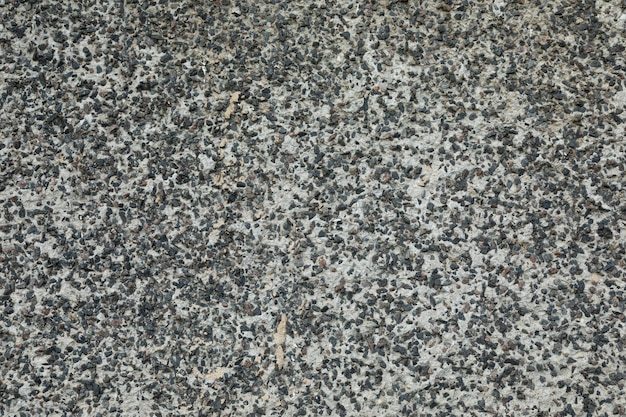 Uneven pavement of beton mixed with gravel