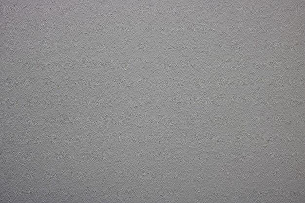 不均一な壁のテクスチャ。灰色の背景
