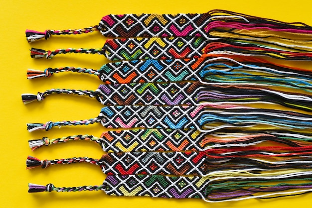 Unfinished diy woven friendship bracelets with abstract geometric pattern