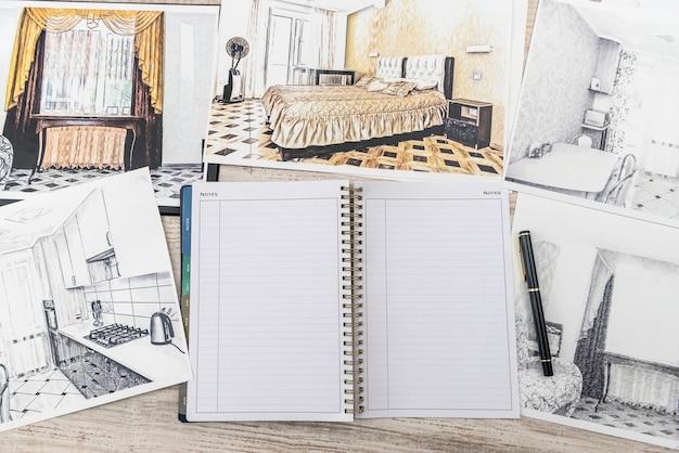 Незаконченный набросок эскиза классической комнаты, пустой блокнот, цветные инструменты на столе