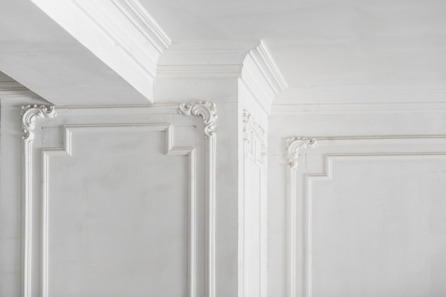 Unfinished plaster molding on the ceiling and columns decorative gypsum finish