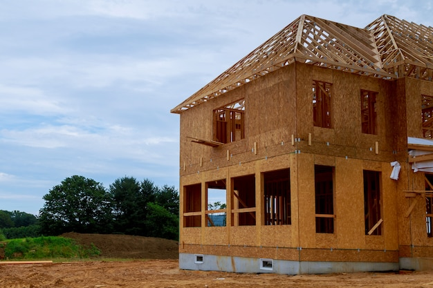 Unfinished wood frame building or framing beam of new house