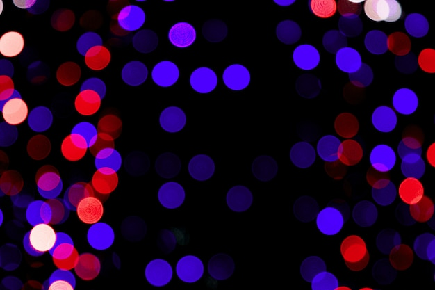 Unfocused abstract colourful bokeh on black background. defocused and blurred many round light