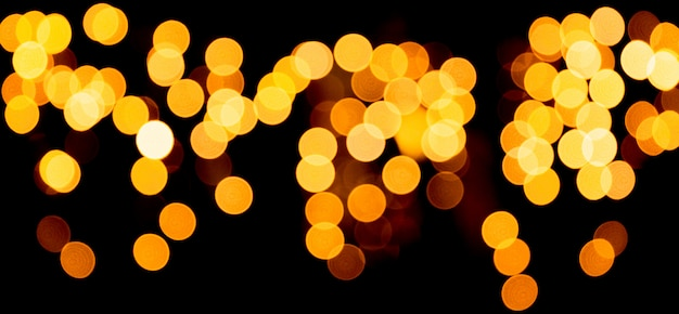 Unfocused abstract gold bokeh on black background