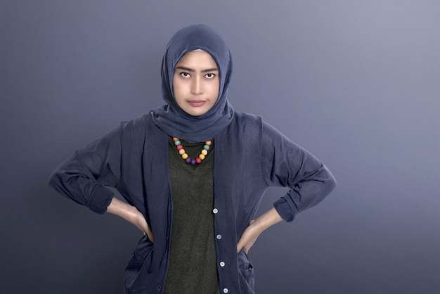Unhappy asian muslim woman standing