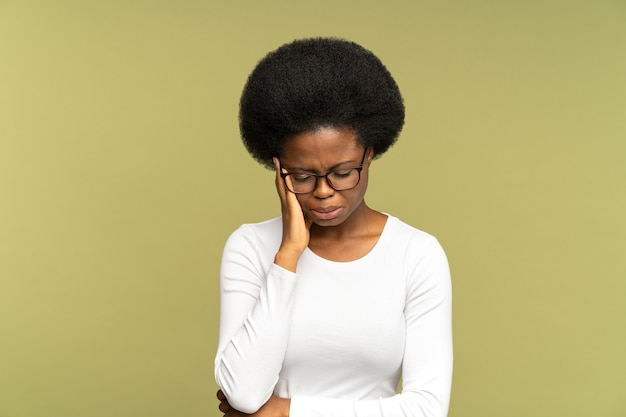 Unhappy black woman cry hiding face with hand tired stressed female disappointed and depressed