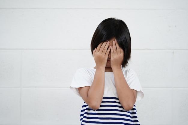 Unhappy cheerful little girl