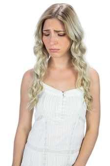 Unhappy curly haired blonde posing